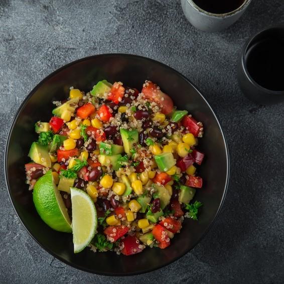 Avocado, quinoa, bean, corn and bell pepper salad . Top view