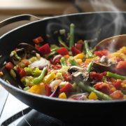 steaming mixed vegetables in the wok, asian style cooking vegetarian and healthy